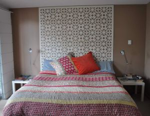 Circles-fretwork-design-as-headboard 1024